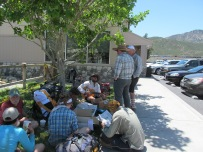 Hikers enjoying the shade outside a gas station