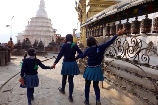 Spinning prayer wheels at the Swayambhunath Stupa