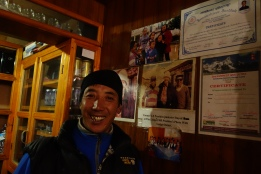 This is Pemba Sherpa. He ownes the Panaorama Lodge. He is standing infront of a picture of Jimmy Carter and his father - when he stayed at the lodge.