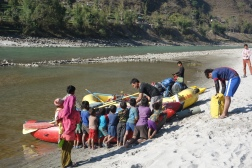 Future river guides watching Rakesh load his boat.